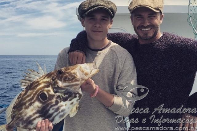 David Beckhan em pescara com o filho