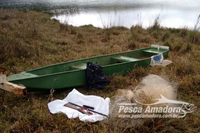 PMA combate a pesca predatoria e apreende barco arma e nove redes no Rio Grande em MG